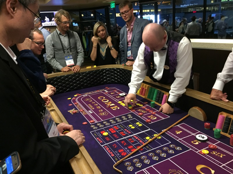 casino dealer gamblers playing